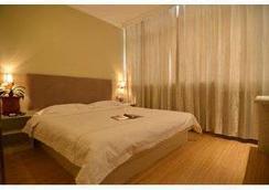 Super 8 Hotel Beijing Lai Guang Ying - Beijing - Kamar Tidur