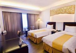 Kyriad Hotel Bumiminang - Kota Padang - Kamar Tidur