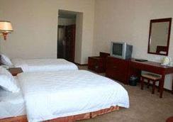 Super 8 Hotel Nanchang Wan Da Xing Cheng - Nanchang - Kamar Tidur