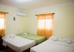 Tropical Island Aparthotel - Santo Domingo - Kamar Tidur