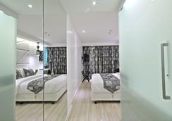 S Sukhumvit Suites Hotel - Bangkok - Kamar Tidur