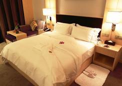Nanning Winwin Hotel - Nanning - Kamar Tidur