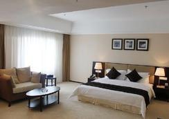 Grand Inn Zhuhai - Zhuhai - Kamar Tidur