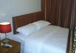 Sun City Hotel - Bangkok - Kamar Tidur