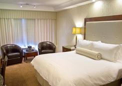 Town & Country Inn and Suites - Charleston - Kamar Tidur