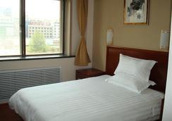 Greentree Inn Shandong Yantai South Avenue Business Hotel - Yantai - Kamar Tidur
