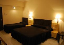Hotel Millennium - Guwahati - Kamar Tidur