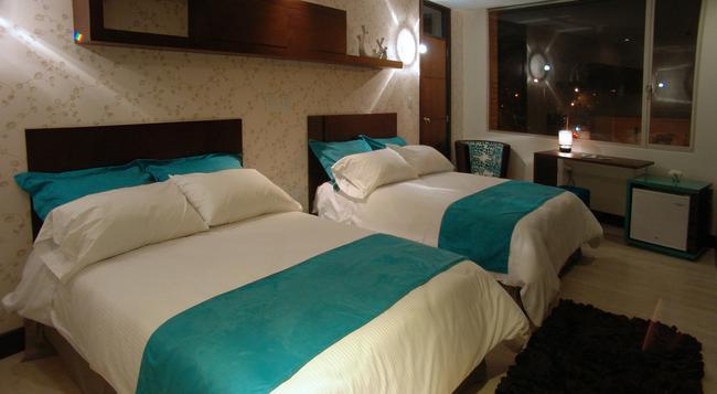 Rioné Hotel Boutique - Cuenca - Bedroom