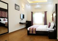 Oriole Resorts - Mysore - Kamar Tidur
