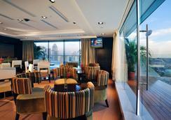 Peninsula Excelsior Hotel - Singapura - Lounge