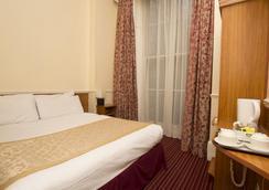 Reem Hotel - London - Kamar Tidur