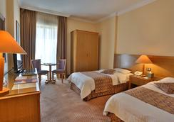 Alqasr Metropole Hotel - Amman - Kamar Tidur