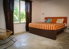 Teetotum Hotel Restaurant Lounge - Tulum - Kamar Tidur