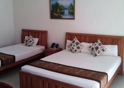 Trans International Hotel - Nadi - Kamar Tidur