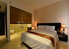 Emilia Hotel by Amazing - Kota Palembang - Kamar Tidur