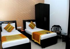 Hotel Universe Inn - New Delhi - Kamar Tidur