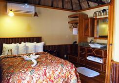 Ramon's Village Resort - San Pedro Town - Kamar Tidur