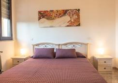 Home Sweet Home - Pisa - Kamar Tidur