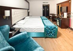 Ege Palas Business Hotel - Izmir - Kamar Tidur