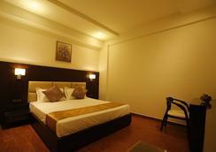 G Hotel - Agra - Kamar Tidur
