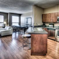 Podollan Rez-idence Grande Prairie Fully equipped kitchen with stainless steel appliances