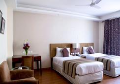 Alpina Hotels & Suites - New Delhi - Kamar Tidur