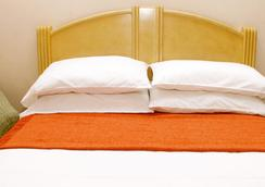 Hotel Lun Fun Manta - Manta - Kamar Tidur
