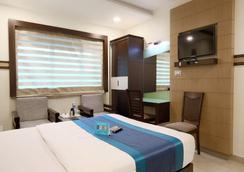 Fabhotel Monarch Jayanagar - Bengaluru - Kamar Tidur