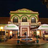 Roomba Inn & Suites Hotel Front - Evening/Night