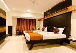 Prajwal By Mango Hotels - Bengaluru - Kamar Tidur