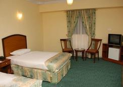 Hotel Crown Inn - Karachi - Kamar Tidur