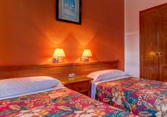 Montana Club Suite Hotel - Puerto del Carmen - Kamar Tidur