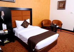 Royal Grand Suite Hotel - Sharjah - Kamar Tidur