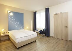 H2 Hotel Berlin Alexanderplatz - Berlin - Kamar Tidur