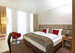 H4 Hotel München Messe - Munchen - Kamar Tidur