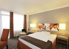 H4 Hotel Frankfurt Messe - Frankfurt - Kamar Tidur
