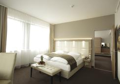 H4 Hotel Berlin Alexanderplatz - Berlin - Kamar Tidur