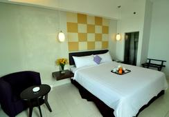 Aston Ketapang City Hotel - Ketapang - Kamar Tidur
