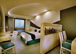 Aston Cirebon Hotel & Convention Center - Kota Cirebon - Kamar Tidur