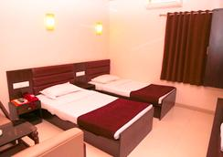 Hotel Golden Plaza - Ahmedabad - Kamar Tidur