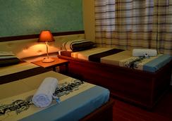 Julieta's Pension House - Puerto Princesa - Kamar Tidur