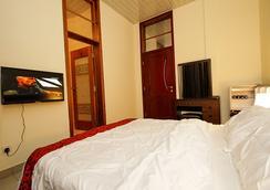 St Augustine Apartment & Hotel - Kigali - Kamar Tidur