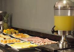 Tempo Rent Apart Hotel - Santiago - Restoran
