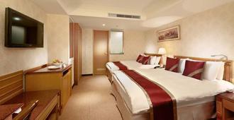Cosmos Hotel Taipei - Kota Taipei - Kamar Tidur