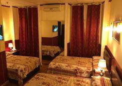 Cairo Inn - Kairo - Kamar Tidur