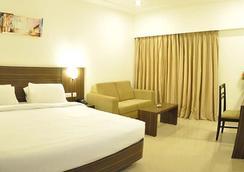 Hotel Midcity - Vijayawada - Kamar Tidur