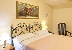 Hotel Stromboli - Roma - Kamar Tidur