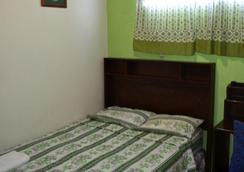 Hotel Oasis - San Salvador - Kamar Tidur
