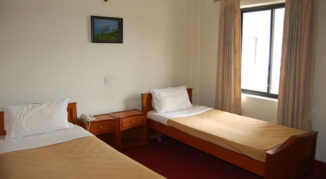 Hotel Norbu Sangpo - Kathmandu - Bedroom