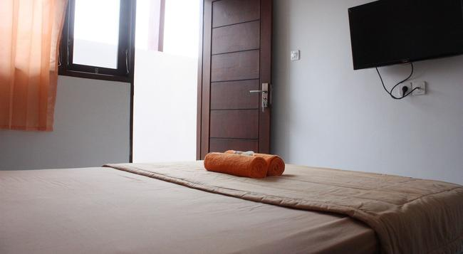 Orchid Guest House - Denpasar - Bedroom